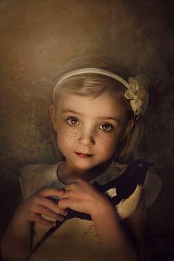 Marta Orlowska LITTLE BLOND GIRL HOLDING MAGPIE Children