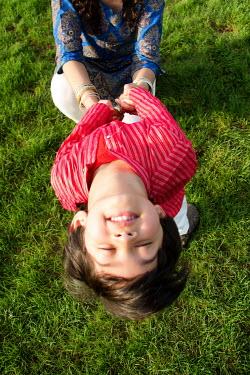 Elisabeth Ansley INDAIN BOY PLAYING WTH MOTHER Children