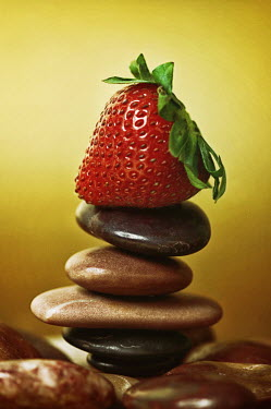 Mashael Hamad AlShuwayer STRAWBERRY BALANCING ON BROWN PEBBLES Miscellaneous Objects