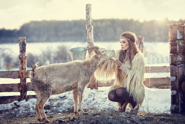 Margarita Kareva WOMAN ON FARM WITH GOAT Women