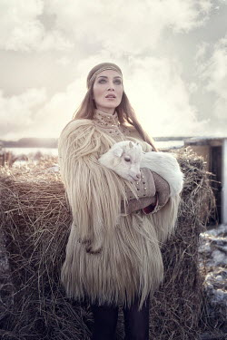 Margarita Kareva WOMAN IN SNOW WITH GOAT Women