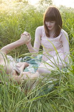 James Walker GIRLS HOLDING HANDS IN MEADOW Women