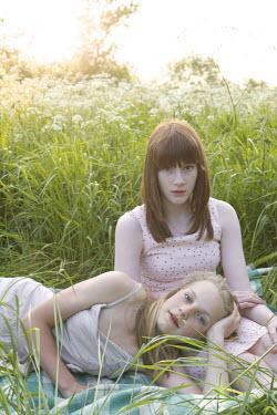 James Walker TWO GIRLS RELAXING IN MEADOW Women