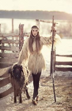 Margarita Kareva WOMAN WITH SHEEP IN SNOW Women