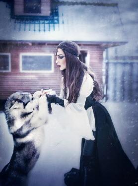 Margarita Kareva WOMAN WITH DOG IN SNOW Women