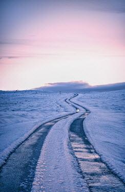 John Herbert Harrison LONG, REMOTE ROAD IN SNOW Roads