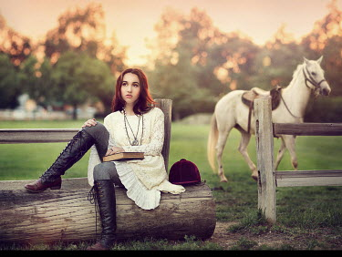 Jessica Drossin WOMAN SITTING WITH WHITE HORSE Women