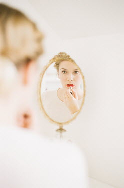 Julianna Collett WOMAN APPLYING LIPSTICK IN MIRROR Women