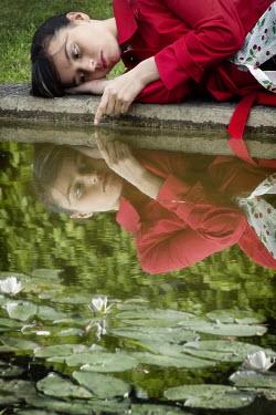 Yolande de Kort WOMAN IN RED BY POND Women
