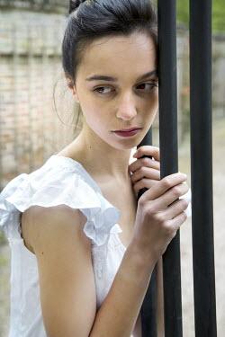 Yolande de Kort WOMAN IN WHITE BY GATE Women