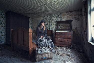 Coltrane Koh WOMAN SITTING IN DERELICT ROOM Women