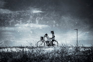 Coltrane Koh TWO CHILDREN RIDING A BIKE Children