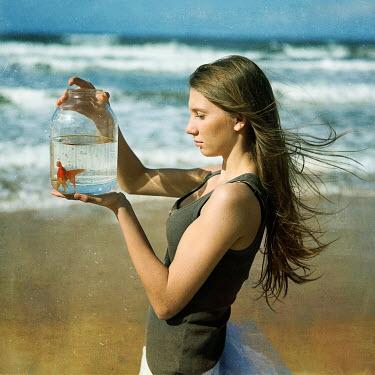Katerina Lomonosov WOMAN WITH GOLDFISH ON BEACH Women