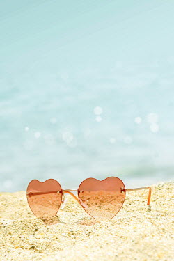 ILINA SIMEONOVA PINK SUNGLASSES ON SANDY BEACH Miscellaneous Objects