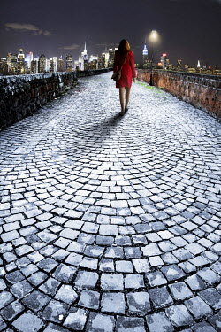 Tim Daniels WOMAN ON COBBLES IN CITY Women