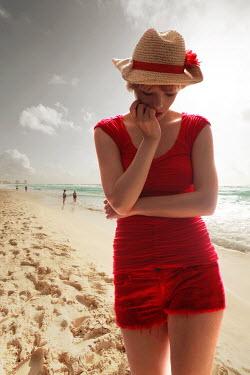 ILINA SIMEONOVA WOMAN IN RED ON BEACH Women