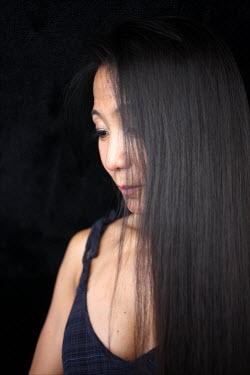 David Gibson ASIAN WOMAN WITH DARK HAIR Women