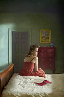 Richard Tuschman WOMAN IN DRESS ON BED Women