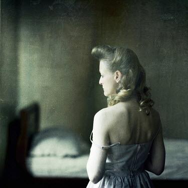Richard Tuschman SAD WOMAN STANDING IN BEDROOM Women