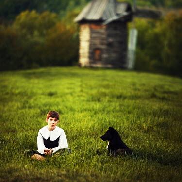 Natalia Ciobanu CHILD IN FIELD WITH DOG Children
