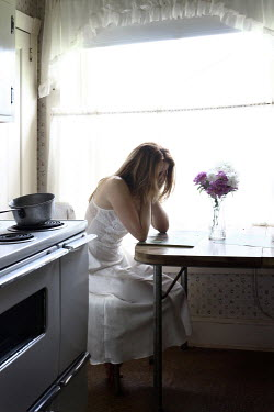 Stephen Carroll WOMAN CRYING IN KITCHEN Women