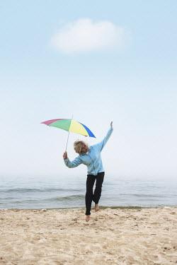 Terry Bidgood GIRL WITH UMBRELLA ON BEACH Children
