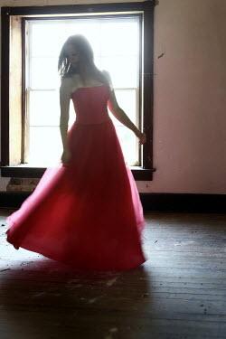 Stephen Carroll WOMAN INDOORS IN RED DRESS Women