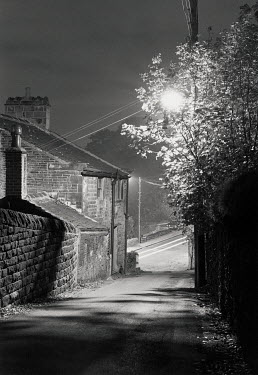 Andrew Sanderson HOUSE AND STREET LAMP AT NIGHT Houses