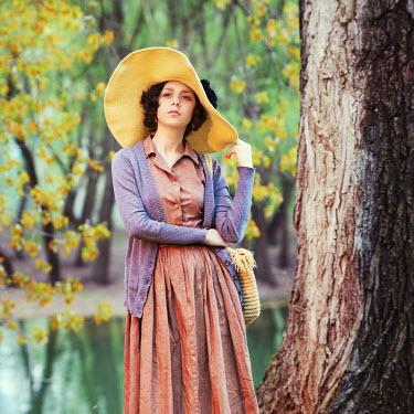Vitali Bolucevschi WOMAN IN HAT BY TREE Women