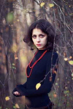 Vitali Bolucevschi WOMAN BY TREE WITH BEADS Women
