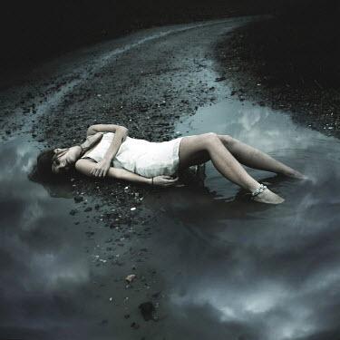 Mariesol Fumy DEAD WOMAN LYING ON ROAD Women