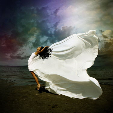 Mariesol Fumy WOMAN JUMPING BY WINDY SEA Women