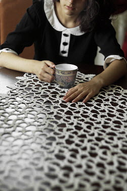 Veronica Gradinariu GIRL AT TABLE WITH CUP Women