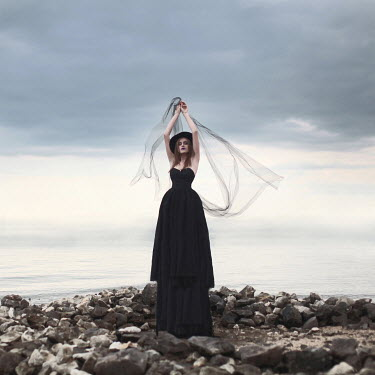 Sanja Kulusic GOTHIC WOMAN ON ROCKS BY SEA Women