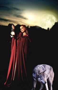 John Herbert Harrison WOMAN WITH LAMP AND WOLF Women
