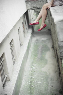 Veronica Gradinariu WOMAN'S LEGS HANGING OVER LEDGE Children
