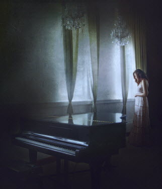 Vanessa Ho WOMAN STANDING WITH PIANO Women
