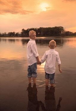 Jake Olson BOYS STANDING IN THE WATER Children