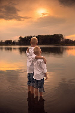 Jake Olson BOYS STANDING IN THE WATER EMBRACING Children