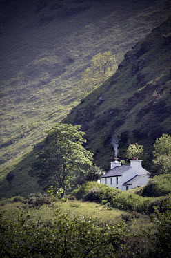 Adrian Muttitt REMOTE COTTAGE IN THE HILLS Houses
