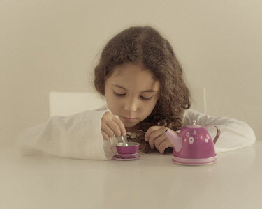 Maria Jose Rivera GIRL WITH TOY TEA SET Children