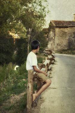 Maria Jose Rivera BOY SITTING ON WOODEN FENCE Women