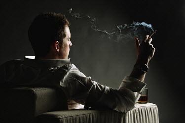 Martin Castein MAN IN CHAIR SMOKING Men