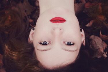 Karin Lips WOMAN LYING IN LEAVES Women