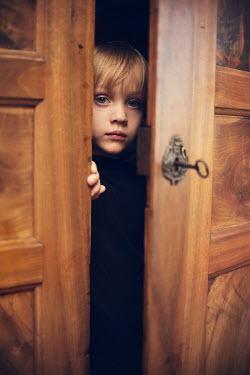 Kelly Sillaste CHILD PEERING THROUGH DOOR Children
