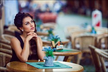 Margarita Kareva WOMAN AT CAFE TABLE Women