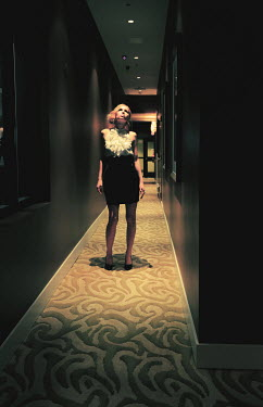 Fang Tong WOMAN STANDING IN HOTEL CORRIDOR Women