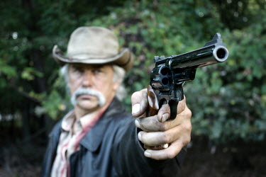Stephen Carroll OLD COWBOY WITH REVOLVER Old People