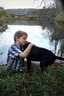 Stephen Carroll BOY WITH DOG BY POND Men