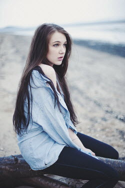 Sam Williamson TEENAGE GIRL ALONE ON BEACH Women